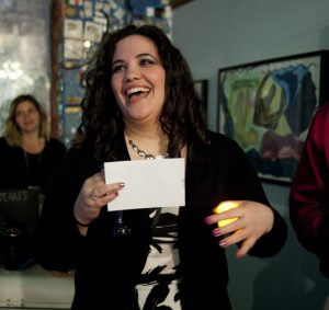 Aimee B laughing as she leads Shabbat candle lighting