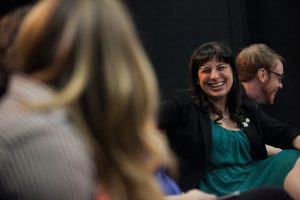 Young woman laughing as she interacts with a peer at Pitch Night