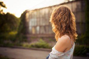 Woman looking away toward the road