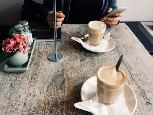 Coffee date on a wooden table