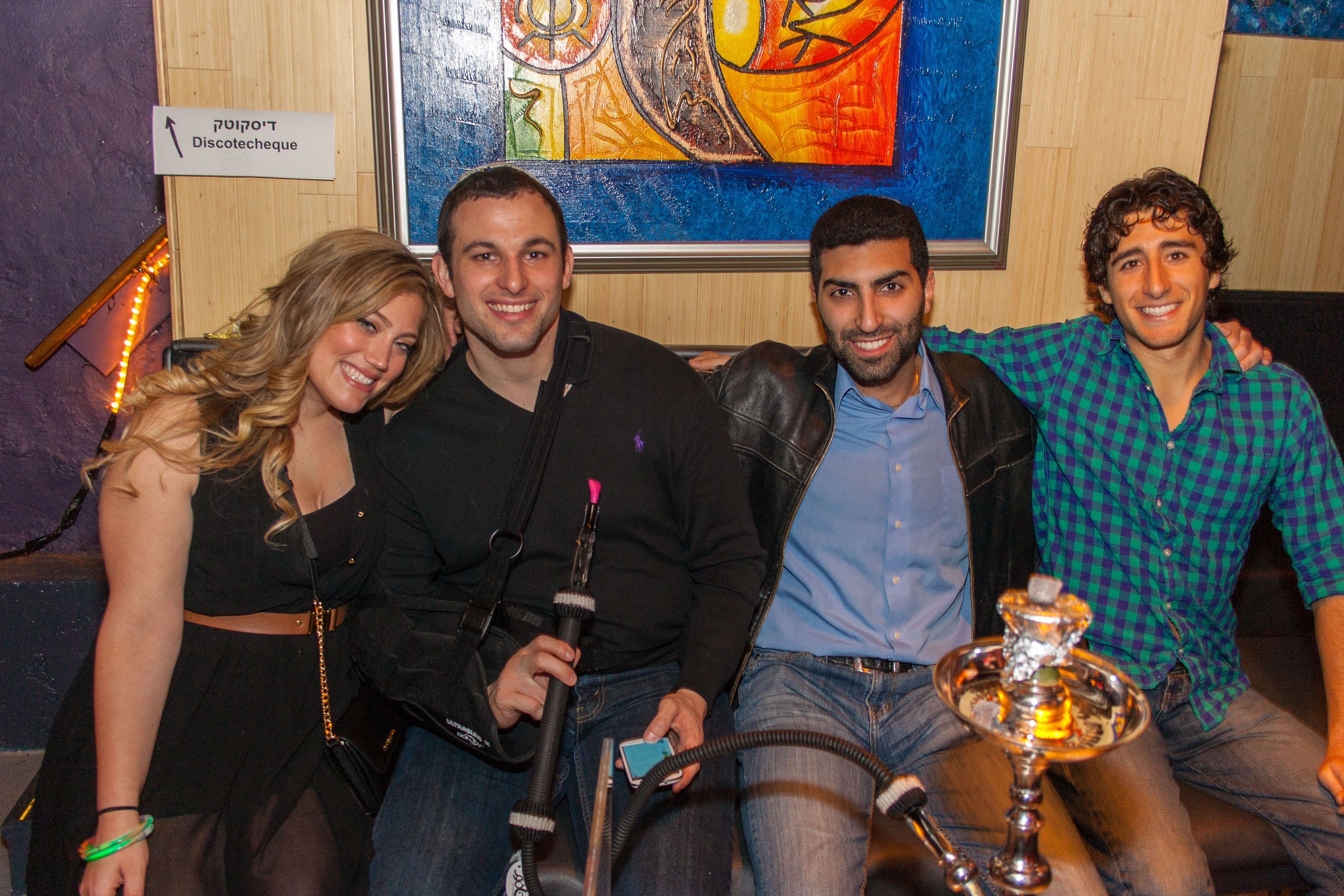 group of young professionals hanging out at a hookah bar at Mesiba 2015