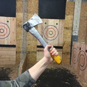 An axe is held up in front of a target