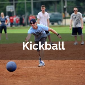 Young man throwing kickball on field