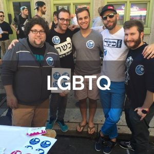 """Group of young men at Pride event with stickers that read """"I (heart) nice Jewish boys"""""""