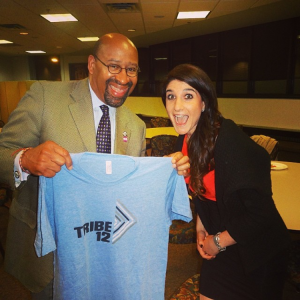 Molly poses with Mayer Nutter, who is holding an old Tribe 12 shirt