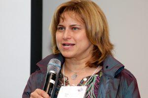 Elisa Heisman holding microphone