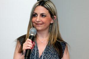 Erica Fagje holding microphone