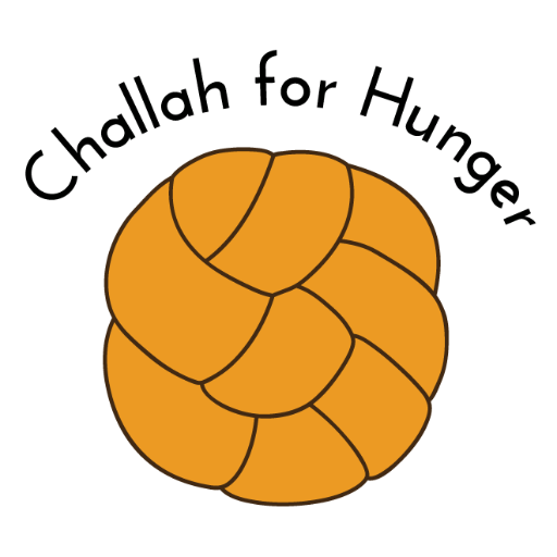 A gold challah with 'Challah for Hunger' written over top