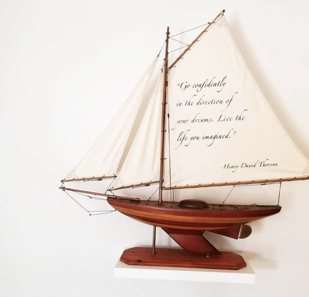 Henry David Thoreau quote written on the sail of a ship