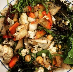 Birds eye view of a fall salad with peppers, carrots, chickpeas, and cauliflower