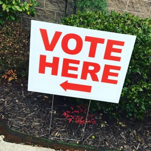 Vote Here Sign with an arrow