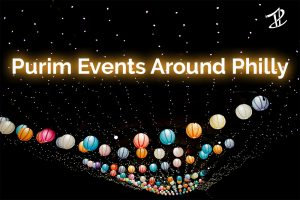 """An image of paper lanterns on string lights with the words """"Purim Events Around Philly"""""""