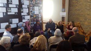 Six people sitting on a bench. From left to right: Madina and Salawat, high school students at Northeast High School, Rabbi Tiferet Berenbaum, Joel, a holocaust survivor, Randi Boyette, Associate Regional Director of Education at the Anti-Defamation League, and Alix Rosenfeld, dramaturg.