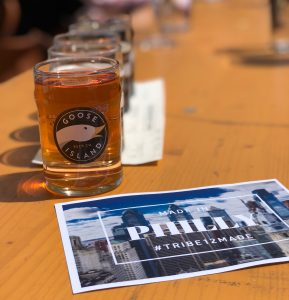 A flight of Goose Island beers and a postcard for the Made in Philly Bar Crawl event for Jewish young professionals