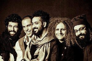 5 musicians of the band Yemen Blues smile at the camera