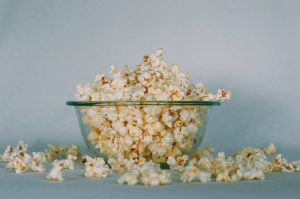 Glass bowl overflowing with popcorn