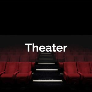 A dark, empty theater with red velvet seats