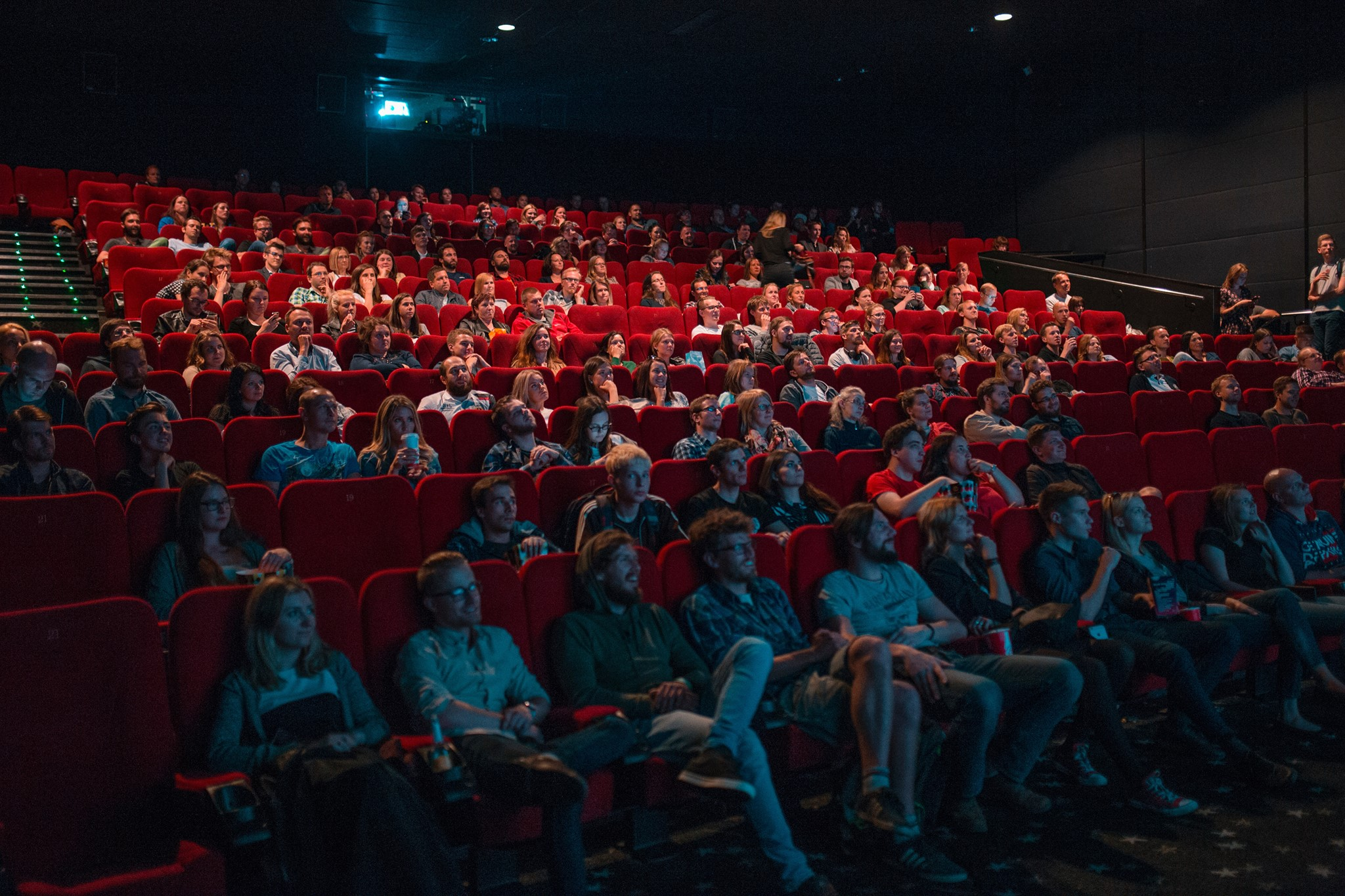 An audience fills the house at the theater
