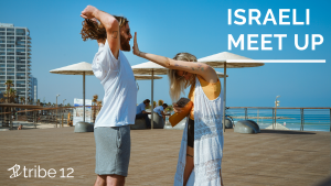 """Image with two people near a beach with the words """"Israeli meet up"""""""