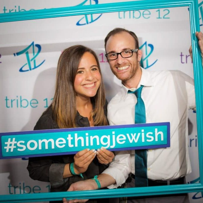 Couple holding a #somethingjewish sign